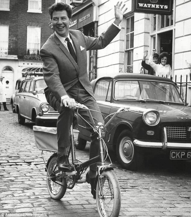 Max Bygraves - with a Triumph Herald Convertible